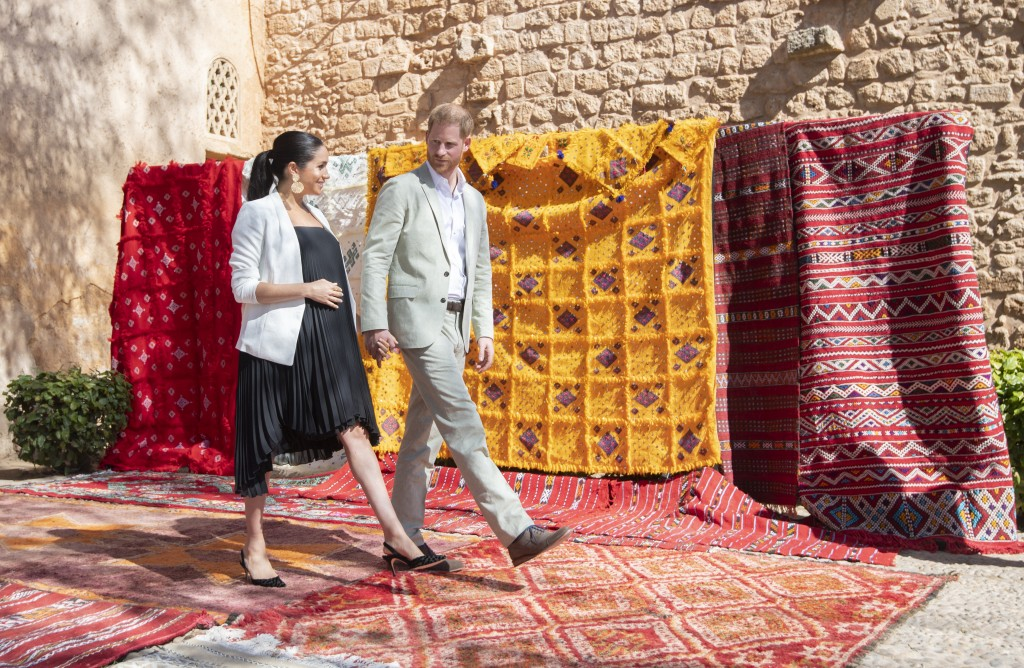 File - In this Monday, Feb. 25, 2019 file photo, Britain's Prince Harry and Meghan, Duchess of Sussex visit the Andalusian Gardens in Rabat, Morocco.