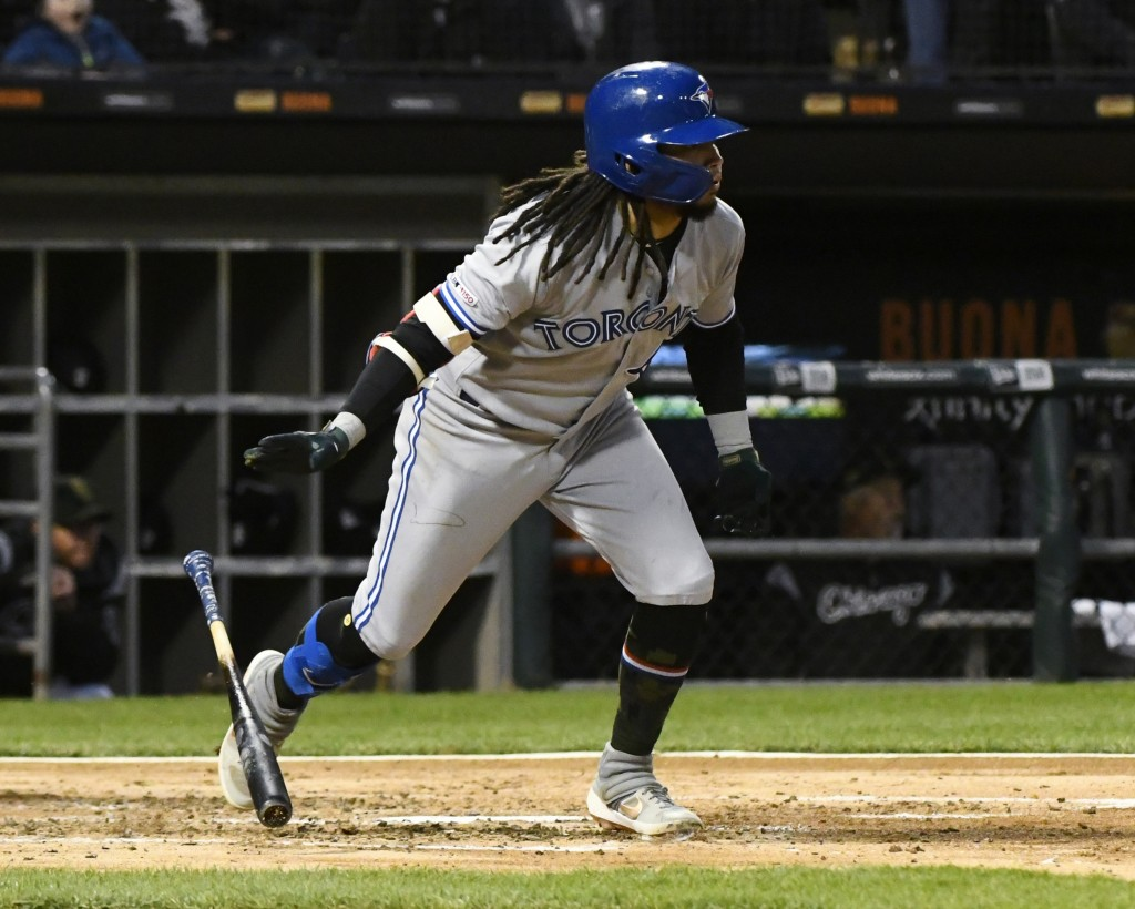 Toronto Blue Jays' Freddy Galvis runs to first base after hitting an RBI single during the third inning of the team's baseball game against the Chicag