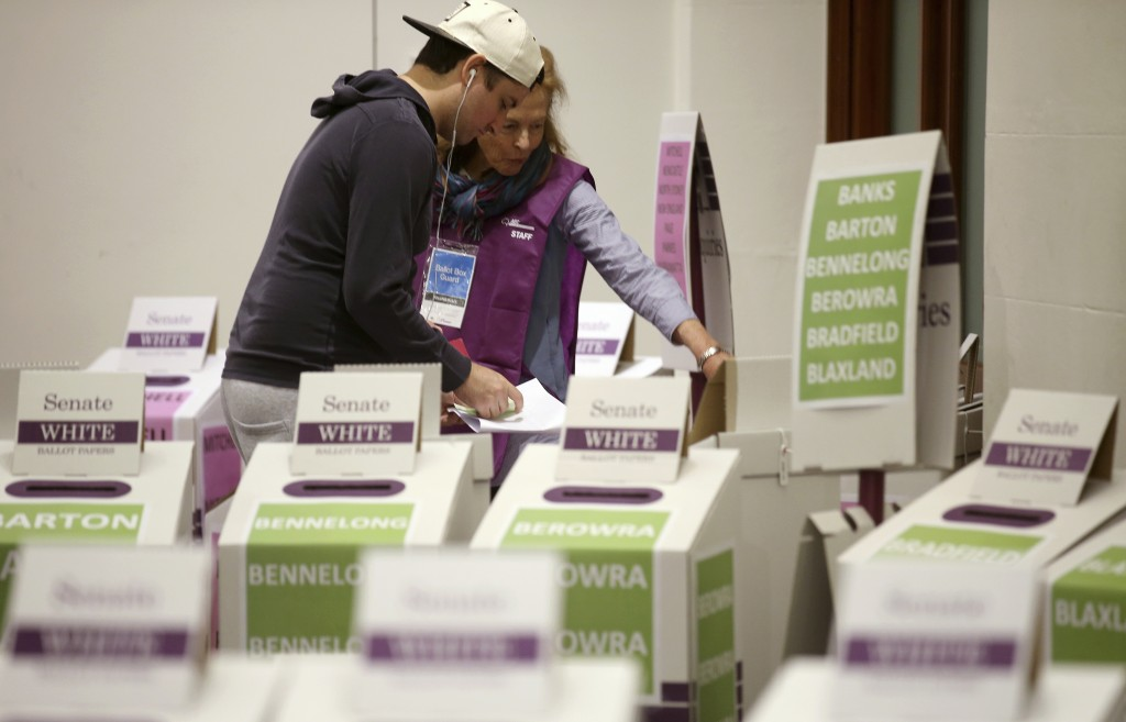 A voter casts their ballot at Town Hall in Sydney, Australia, in a federal election, Saturday, May 18, 2019. Polling stations have opened in eastern A
