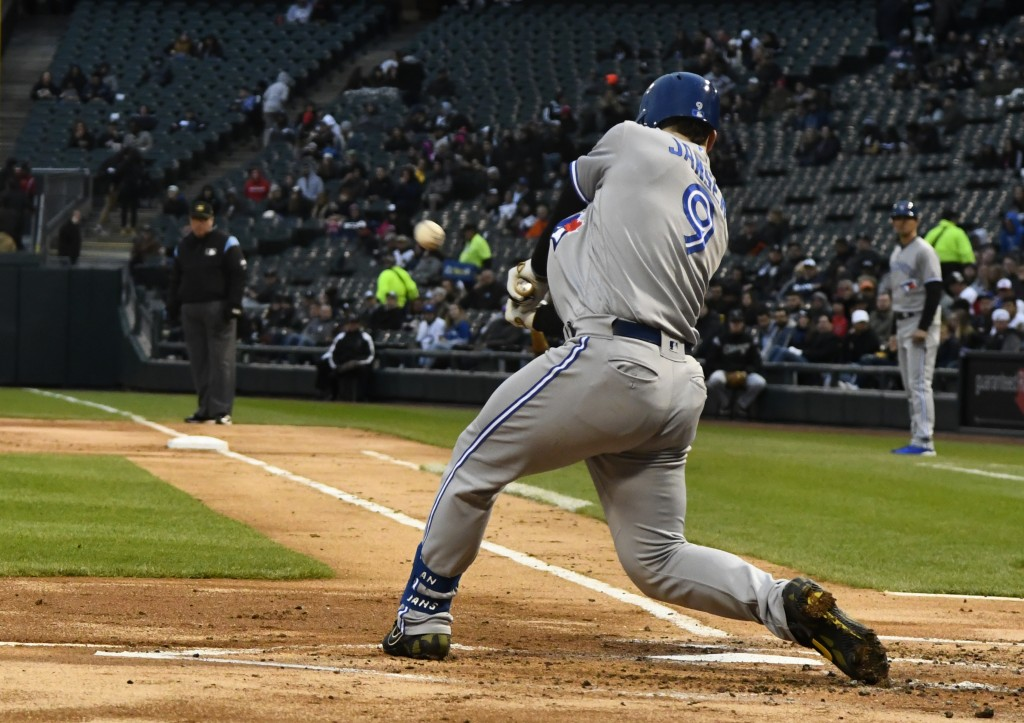 Toronto Blue Jays' Danny Jansen hits a two-run home run during the second inning of the team's baseball game against the Chicago White Sox on Friday,