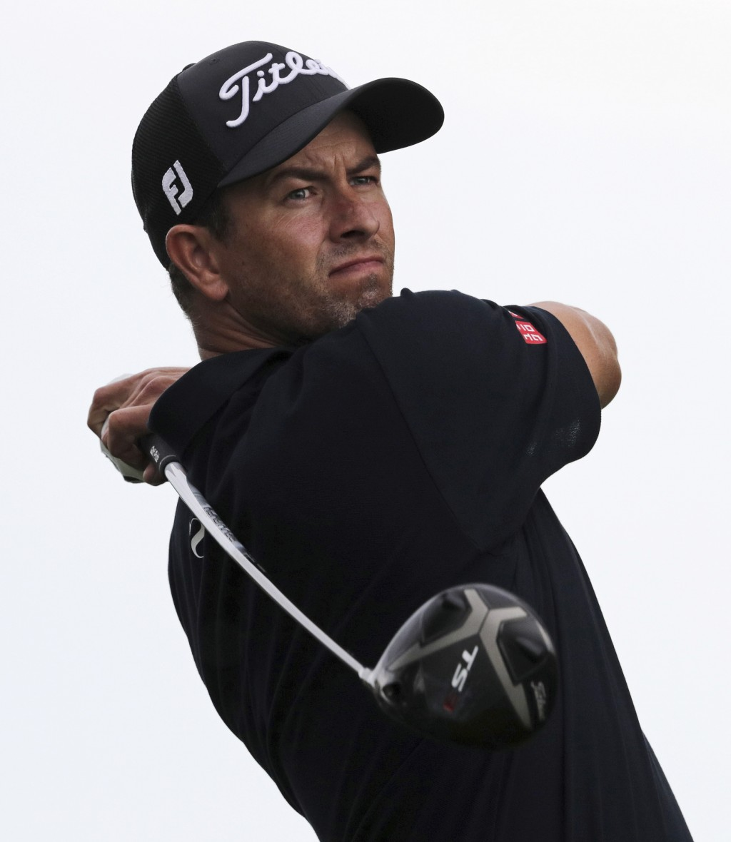 Adam Scott, of Australia, follows through on a tee shot off the 10th hole during the second round of the PGA Championship golf tournament, Friday, May...
