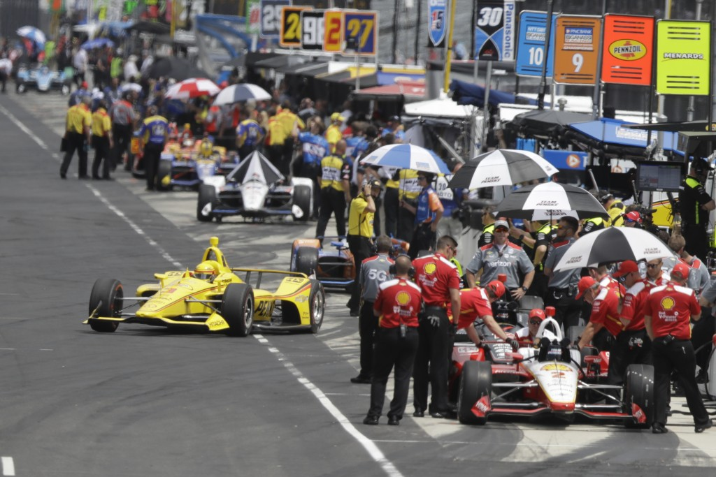Helio Castroneves, of Brazil, pulls out of the pits during practice for the Indianapolis 500 IndyCar auto race at Indianapolis Motor Speedway, Friday,...