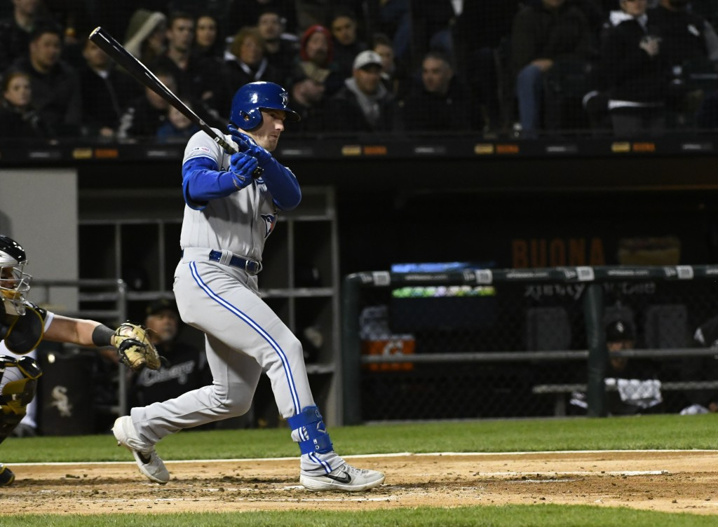 Toronto Blue Jays' Billy McKinney (28) follows through on a two-run double off of Chicago White Sox starting pitcher Ivan Nova during the third inning