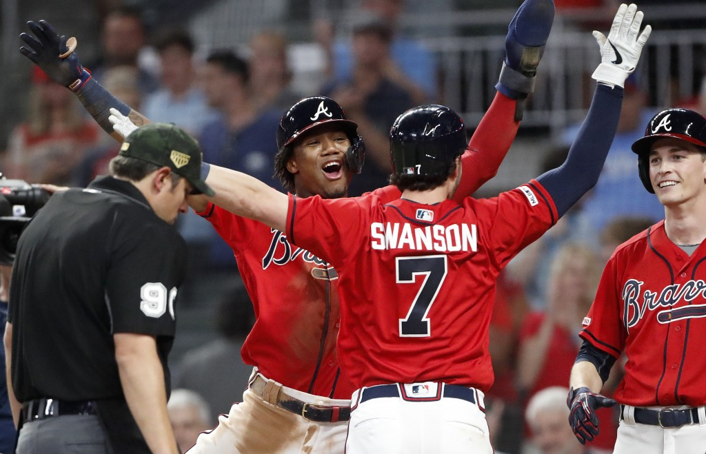 Atlanta Braves' Dansby Swanson (7) celebrates with Ronald Acuna Jr. after hitting a three-run home run in the sixth inning of the team's baseball game