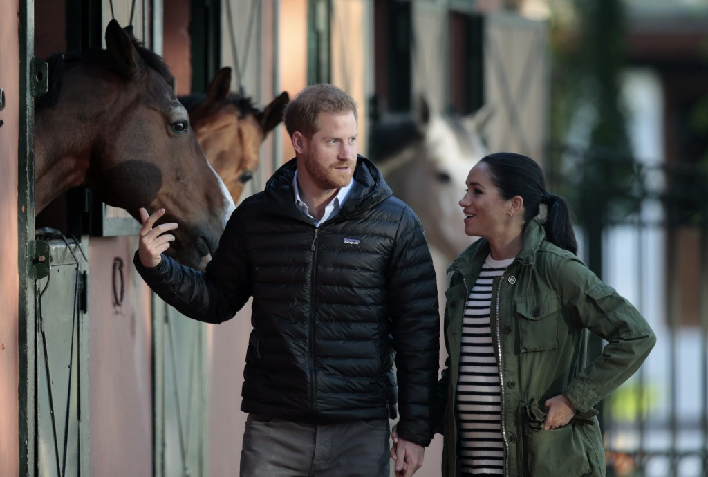 FILE - In this Monday, Feb. 25, 2019 file photo, Britain's Prince Harry and Meghan, Duchess of Sussex, walk together during a visit to the Moroccan Ro