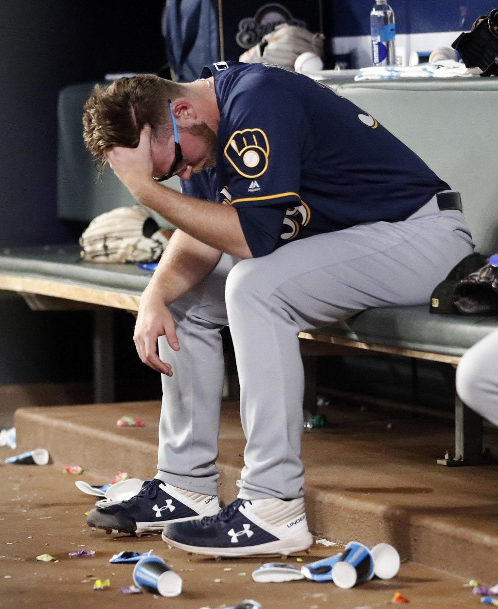 Milwaukee Brewers starting pitcher Corbin Burnes sits on the bench after being removed during the sixth inning of the team's baseball game against the