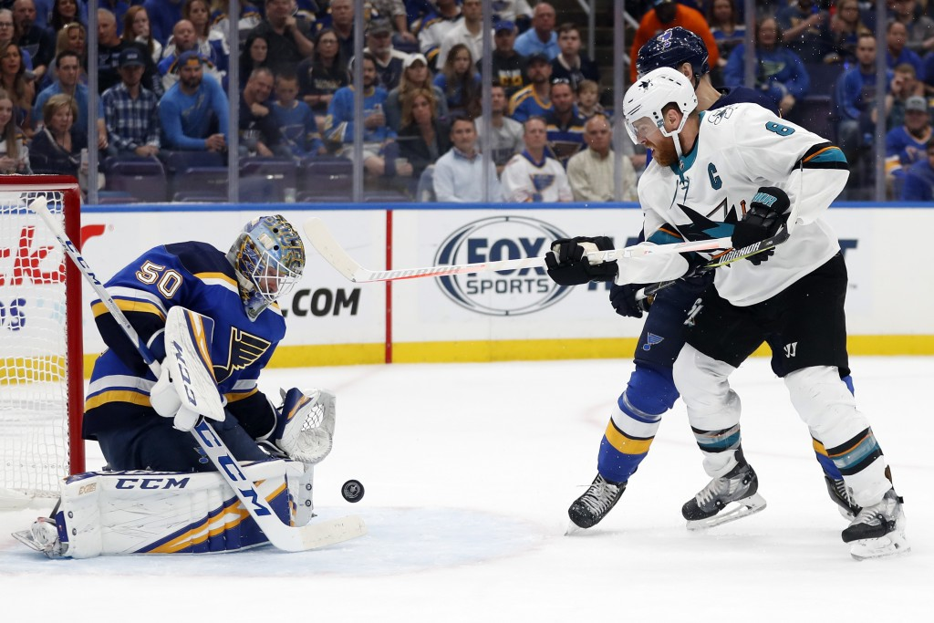San Jose Sharks center Joe Pavelski (8) watches for the rebound as St. Louis Blues goaltender Jordan Binnington (50) blocks a shot during the second p