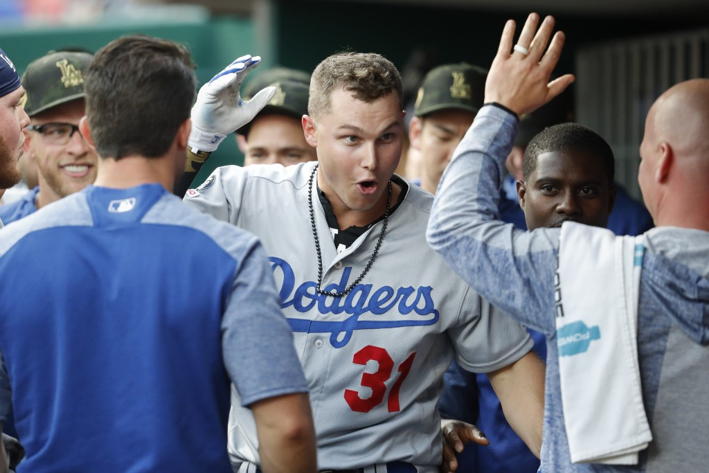 Los Angeles Dodgers' Joc Pederson (31) celebrates in the dugout after hitting a solo home run off Cincinnati Reds starting pitcher Anthony DeSclafani