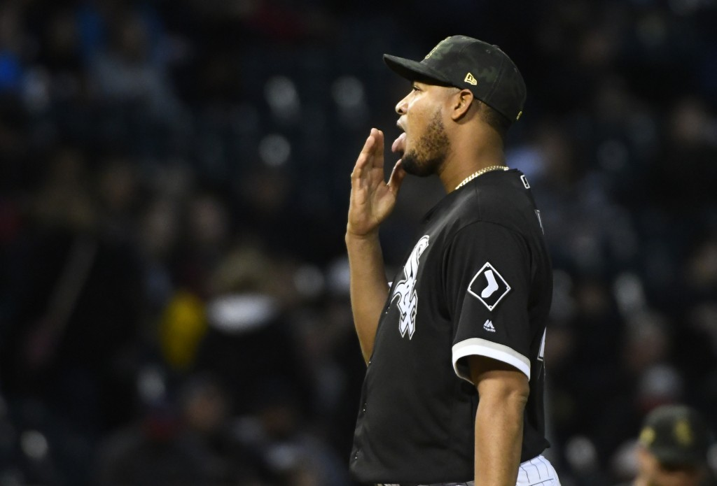 Chicago White Sox starting pitcher Ivan Nova waits after Toronto Blue Jays' Justin Smoak scored during the third inning of a baseball game Friday, May