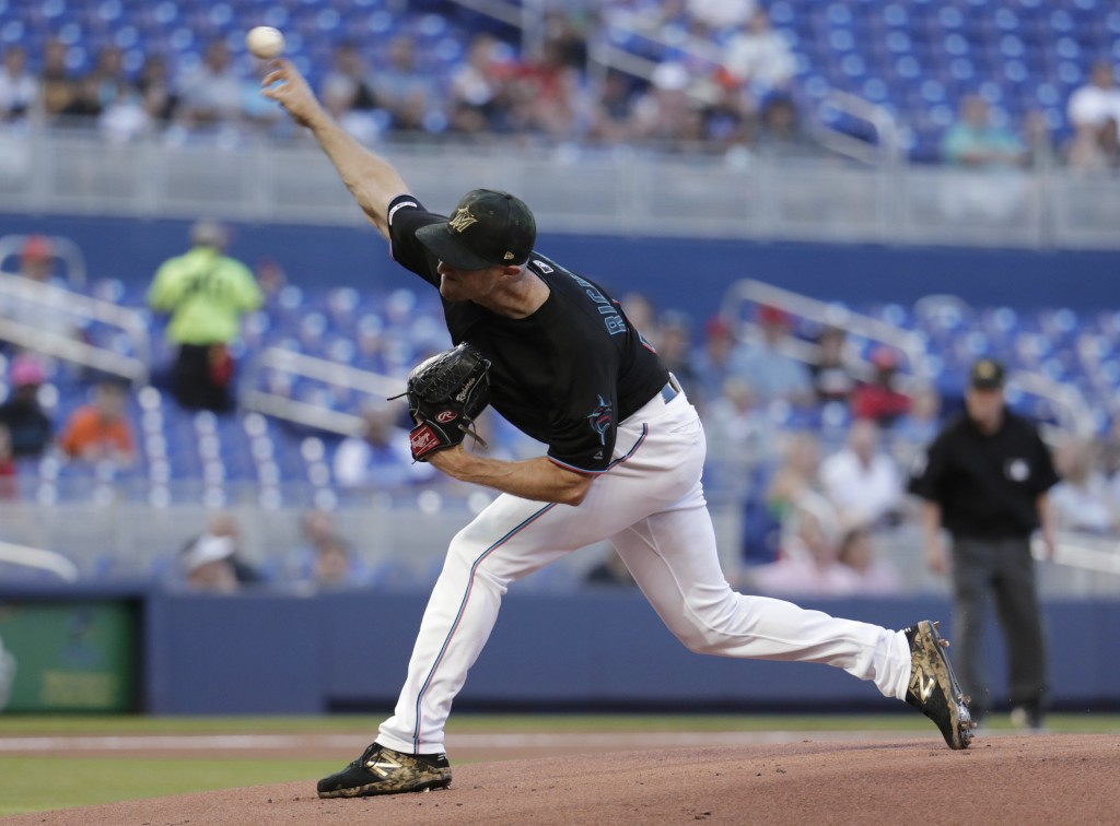 Miami Marlins starting pitcher Trevor Richards throws during the first inning of the team's baseball game against the New York Mets, Friday, May 17, 2...