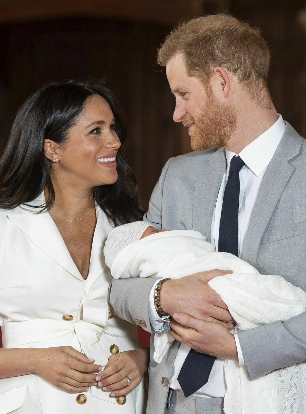 FILE - In this Wednesday, May 8, 2019 file photo, Britain's Prince Harry and Meghan, Duchess of Sussex smile during a photocall with their newborn son