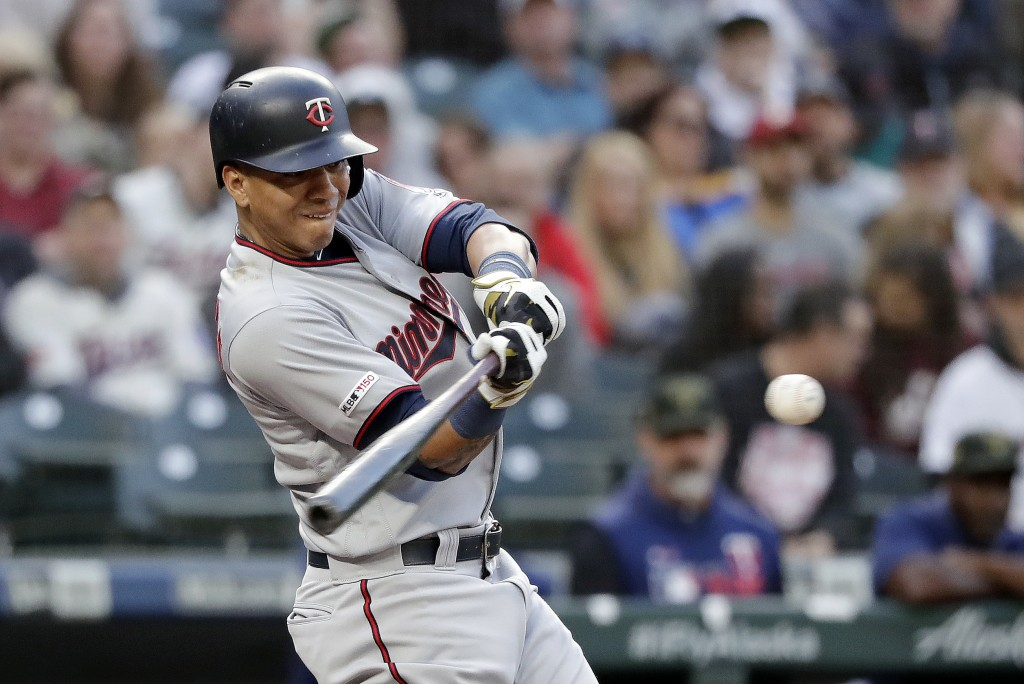Minnesota Twins' Ehire Adrianza connects for a solo home run against the Seattle Mariners during the third inning of a baseball game Friday, May 17, 2