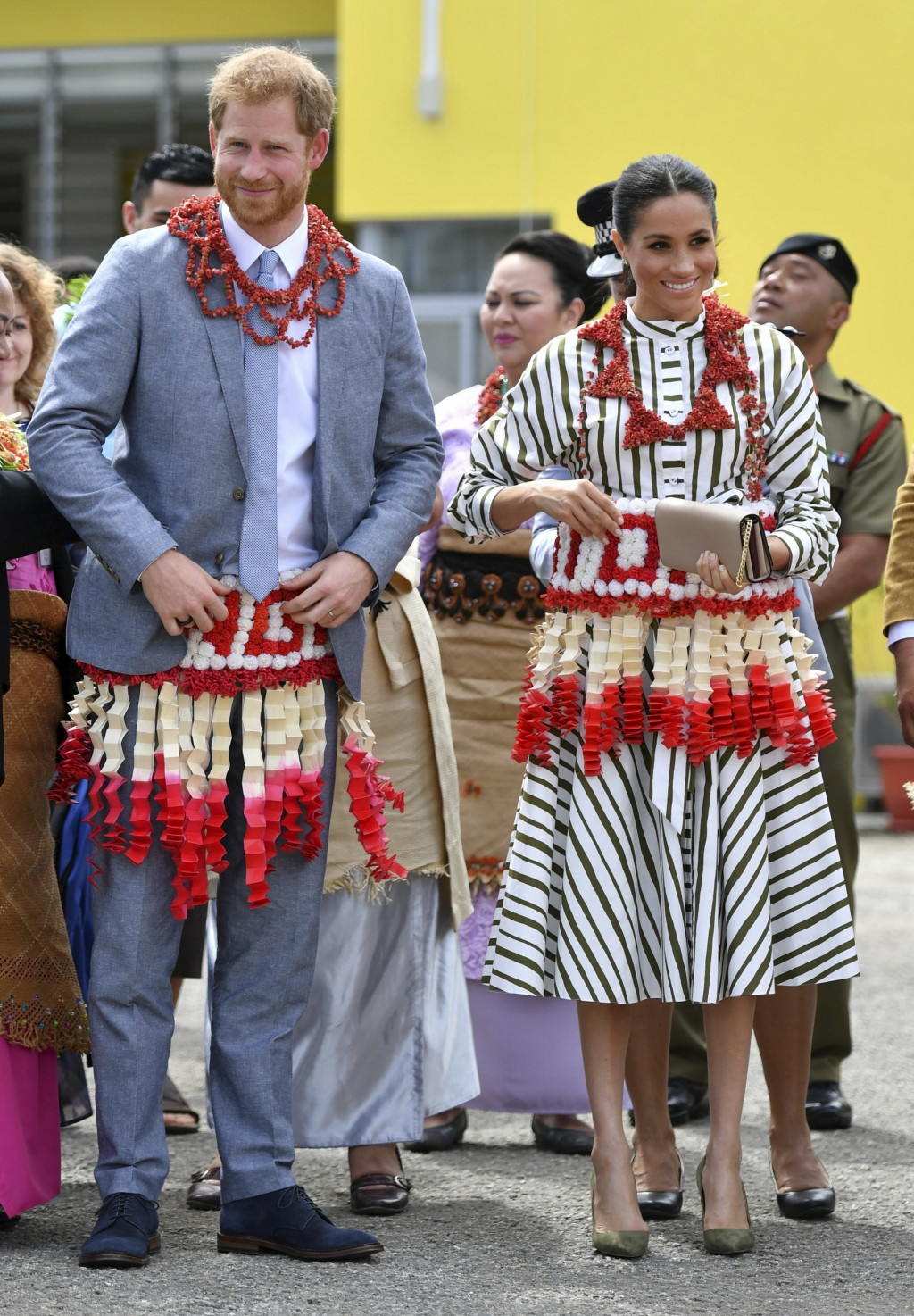 FILE - In this Friday, Oct. 26, 2018 file photo, Britain's Prince Harry and Meghan, the Duchess of Sussex visit an exhibition of Tongan handicrafts, m