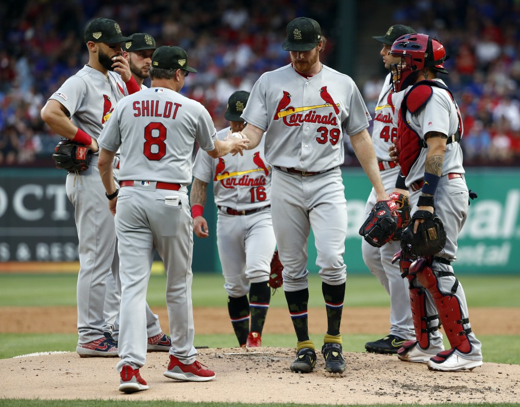 St. Louis Cardinals manager Mike Shildt (8) takes the ball from starting pitcher Miles Mikolas (39) in the second inning of a baseball game against th