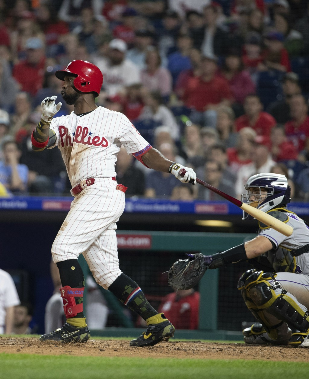 Philadelphia Phillies' Andrew McCutchen watches his two-run home run during the third inning of the team's baseball game against the Colorado Rockies,