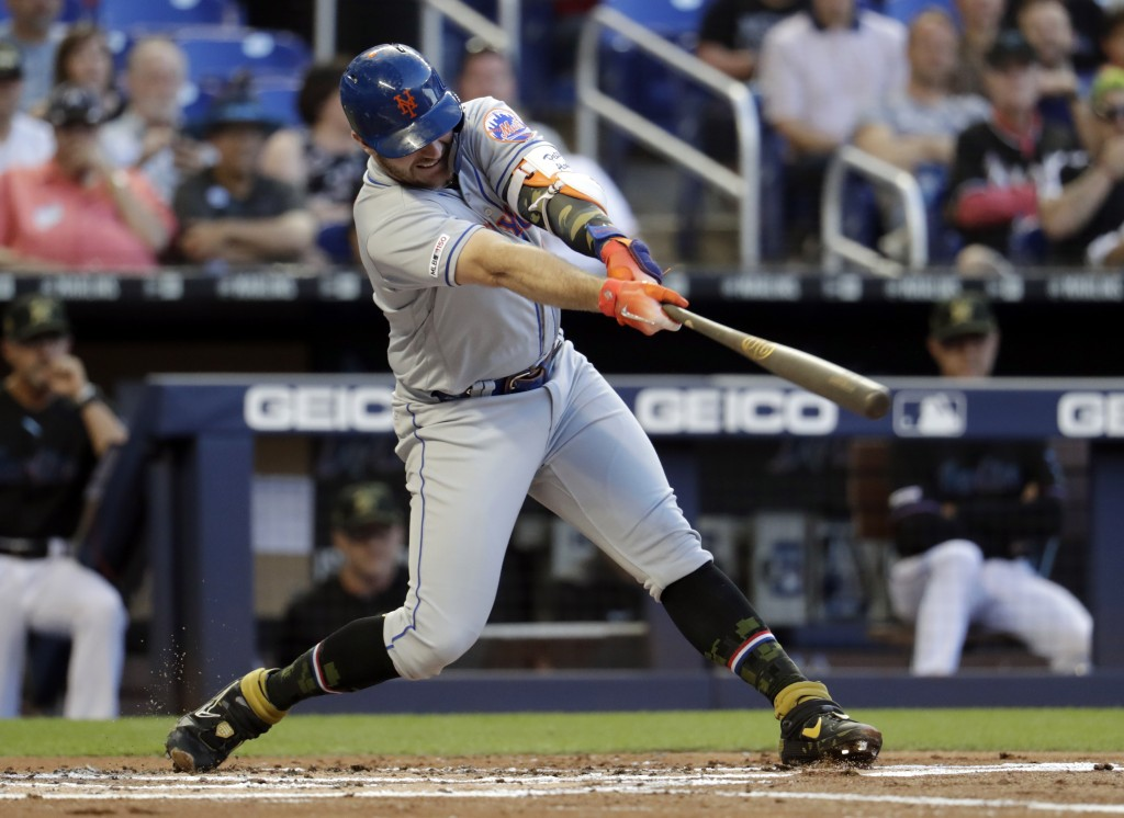 New York Mets' Pete Alonso hits a solo home run during the second inning of the team's baseball game against the Miami Marlins, Friday, May 17, 2019, ...
