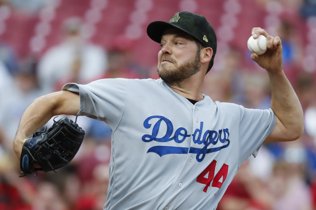 Los Angeles Dodgers starting pitcher Rich Hill throws in the first inning of a baseball game against the Cincinnati Reds, Friday, May 17, 2019, in Cin...