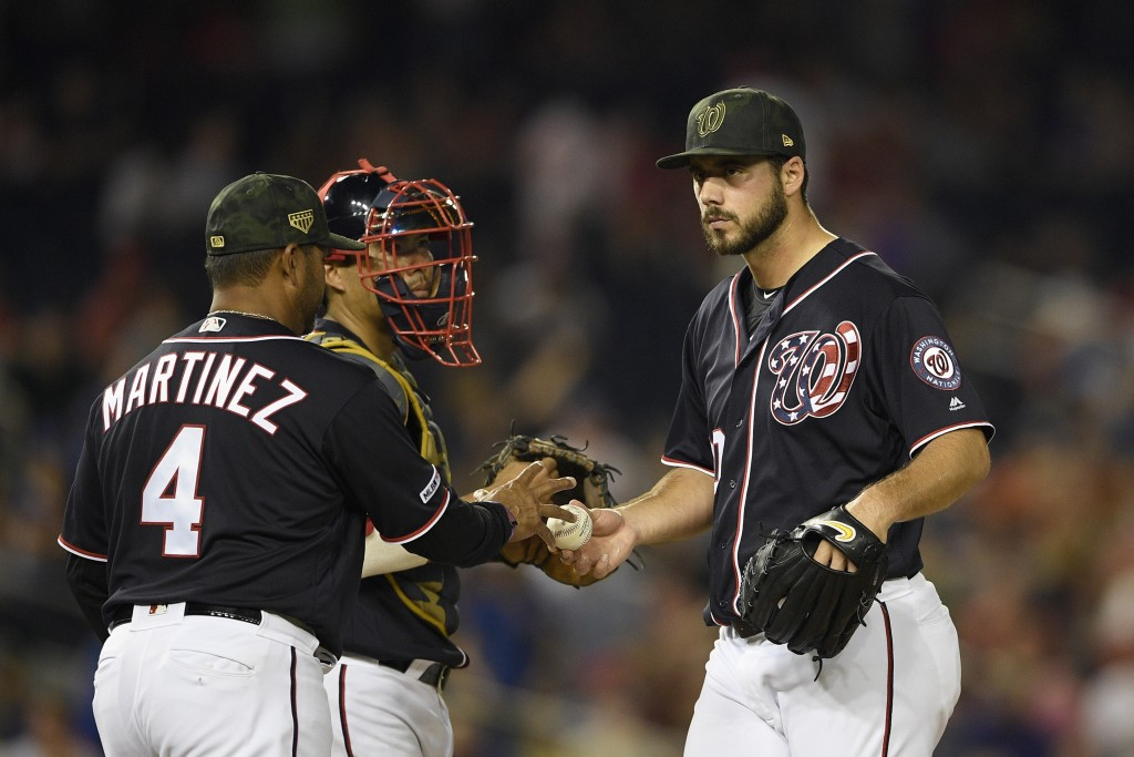 Washington Nationals relief pitcher Kyle Barraclough, right, is pulled from a baseball game by manager Dave Martinez (4) during the eighth inning agai