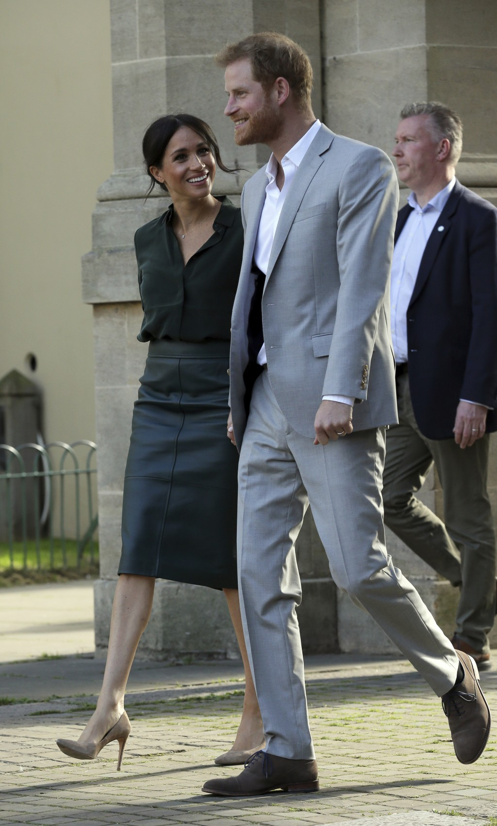 FILE - In this Wednesday, Oct. 3, 2018 file photo, Britain's Prince Harry, right, and Meghan, Duchess of Sussex visit the Pavilion Building in Brighto