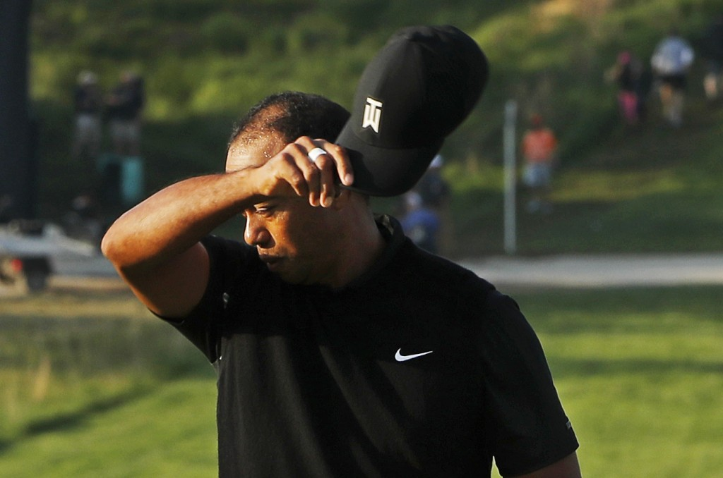 Tiger Woods removes his hat after finishing the second round of the PGA Championship golf tournament, Friday, May 17, 2019, at Bethpage Black in Farmi