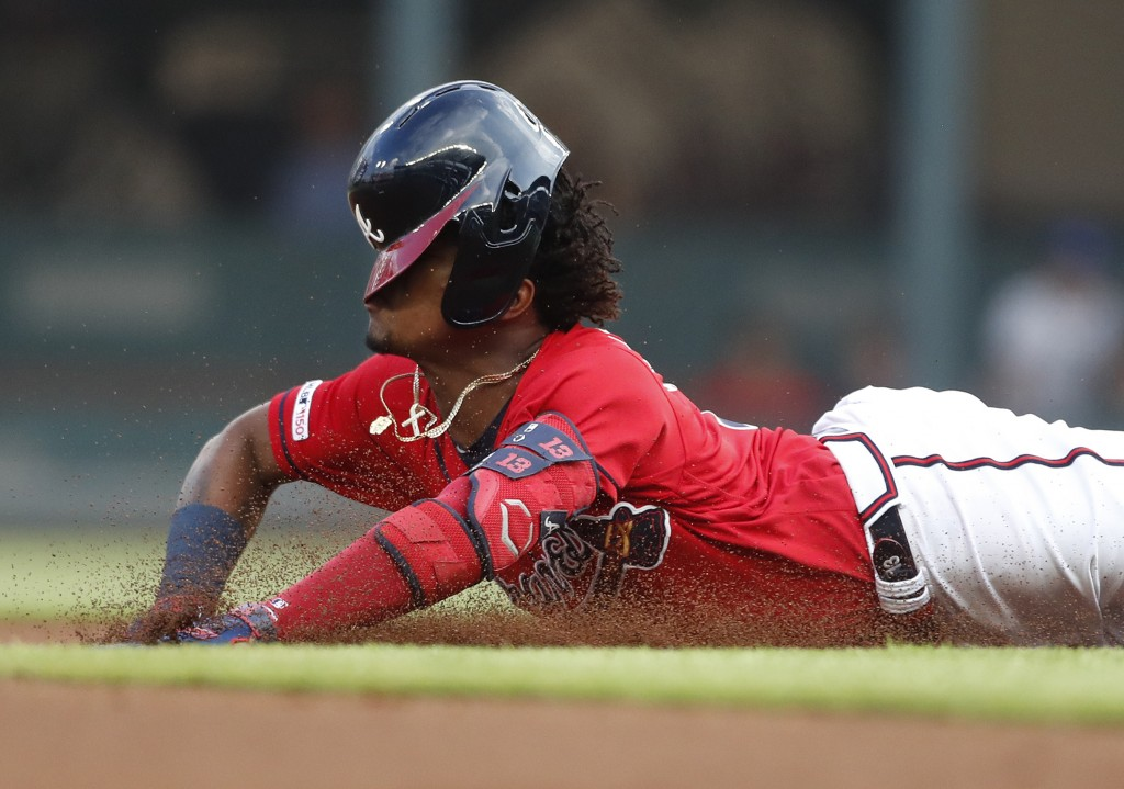 Atlanta Braves' Ronald Acuna Jr. (13) slides into second base with a double during the first inning of the team's baseball game against the Milwaukee