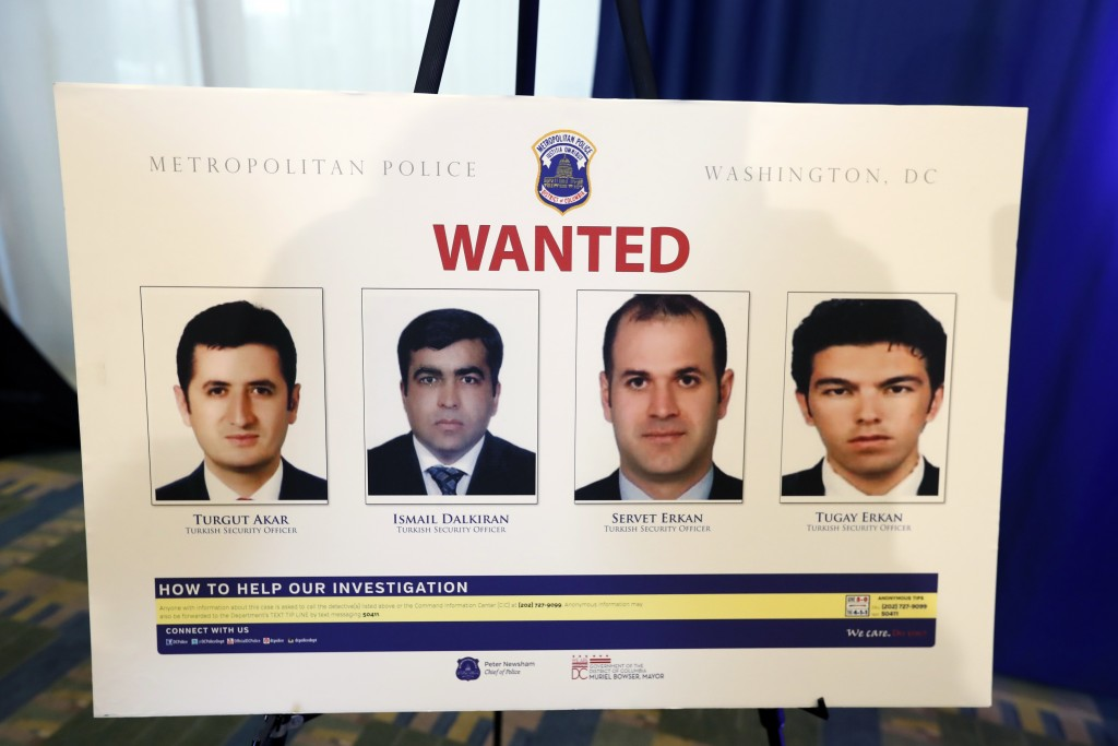 FILE - In this June 15, 2017, file photo, pictures of people facing criminal charges are seen after a news conference in Washington, about an May 16,