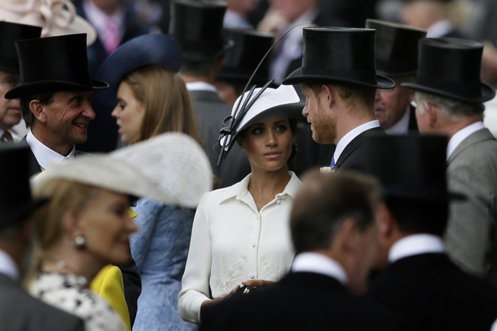 FILE - In this Tuesday, June 19, 2018 file photo, Britain's Prince Harry and Meghan, Duchess of Sussex, arrive on the first day of the Royal Ascot hor