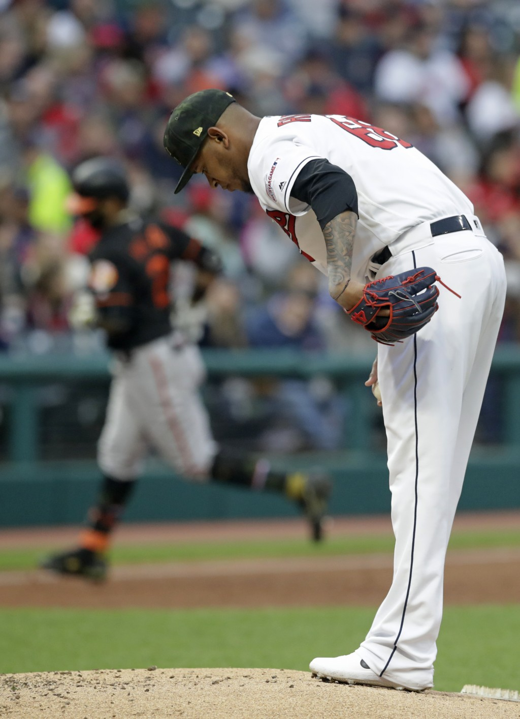 Cleveland Indians starting pitcher Jefry Rodriguez, right, waits for Baltimore Orioles' Jonathan Villar to run the bases after Villar hit a three-run