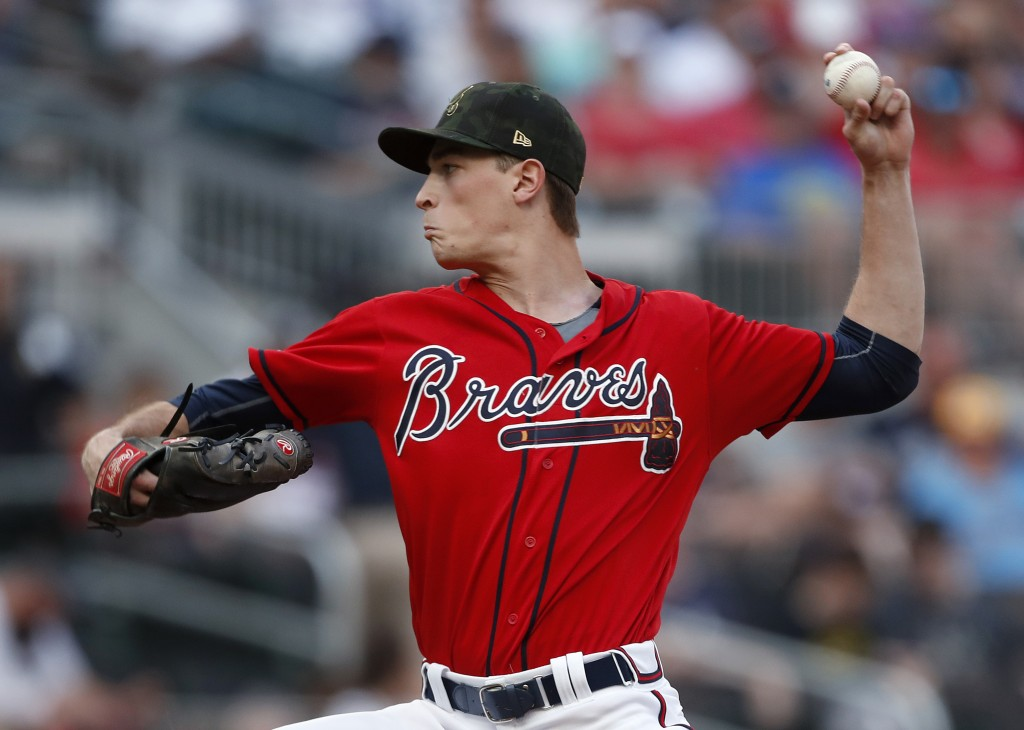 Atlanta Braves starting pitcher Max Fried (54) works in the first inning of a baseball game against the Milwaukee Brewers Friday, May 17, 2019, in Atl