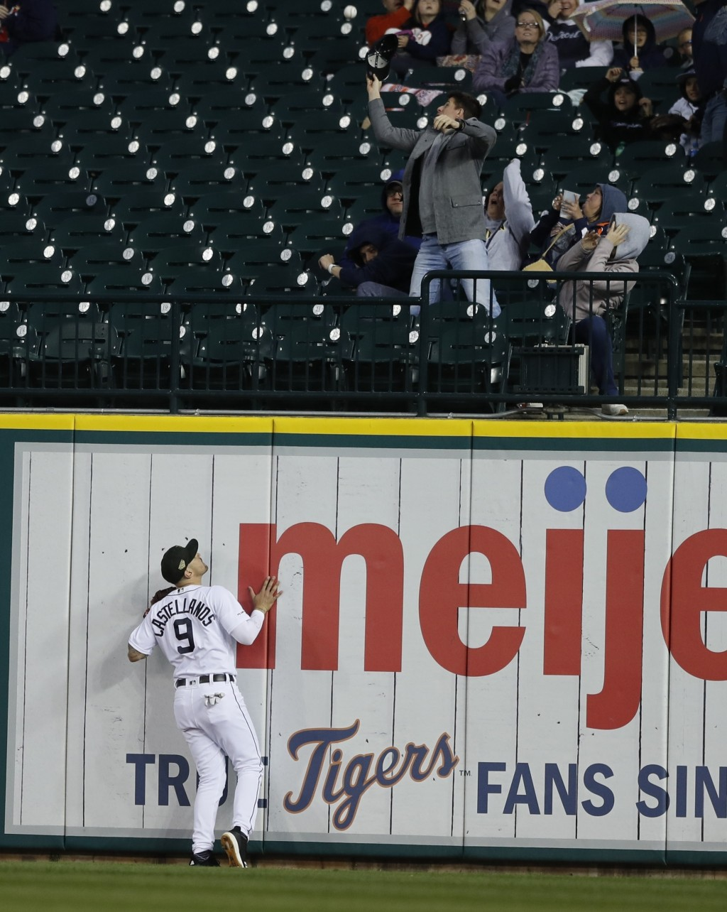 Detroit Tigers right fielder Nicholas Castellanos (9) watches as the two-run home run by Oakland Athletics' Mark Canha clears the wall during the fift