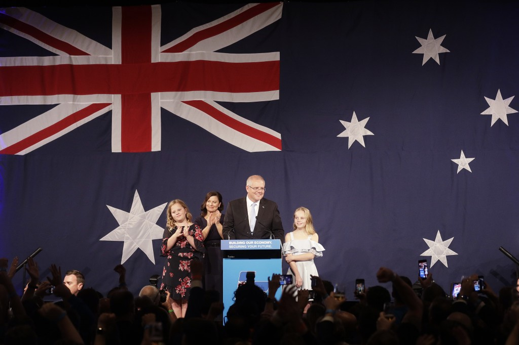 Australian Prime Minister Scott Morrison, second right, arrives on stage to speak to party supporters flanked by his wife, Jenny, and daughters Lily,