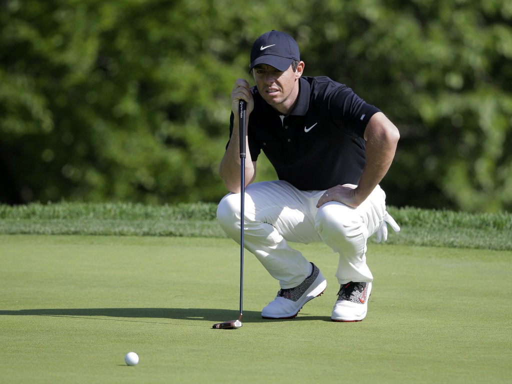 Rory McIlroy of Northern Ireland lines up a putt o...