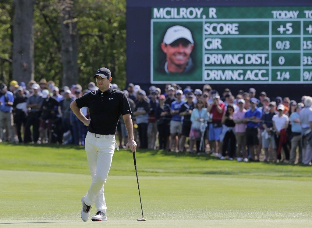 Rory McIlroy, of Northern Ireland, waits to putt on the 13th green during the second round of the PGA Championship golf tournament, Friday, May 17, 20...