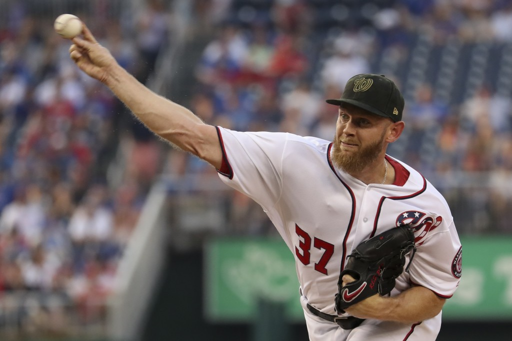 Washington Nationals starting pitcher Stephen Strasburg throws during the first inning of the team's baseball game against the Chicago Cubs, Saturday,