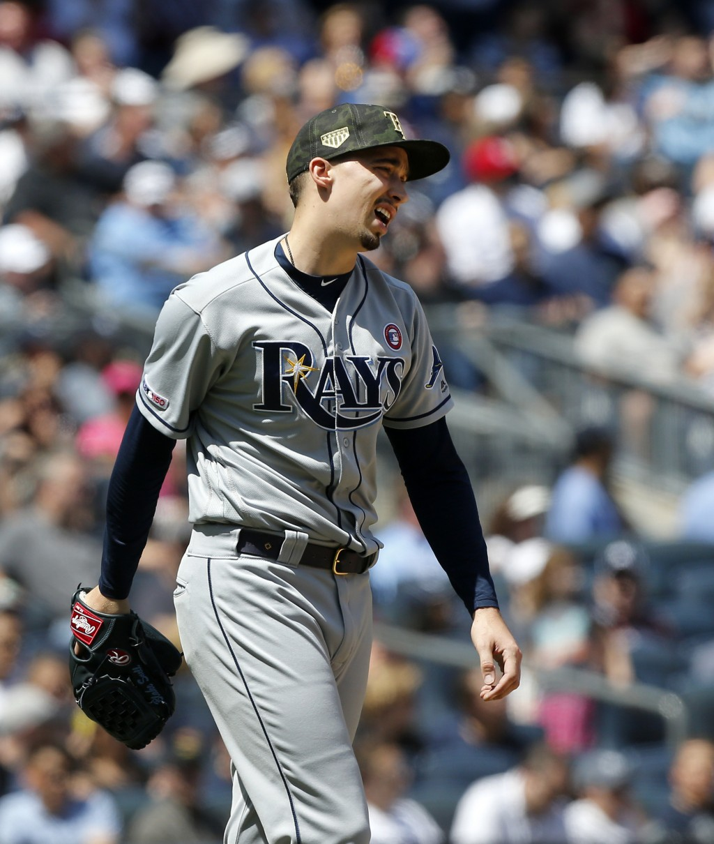 Tampa Bay Rays starting pitcher Blake Snell reacts after walking New York Yankees' Luke Voit to load the bases in the third inning of a baseball game,