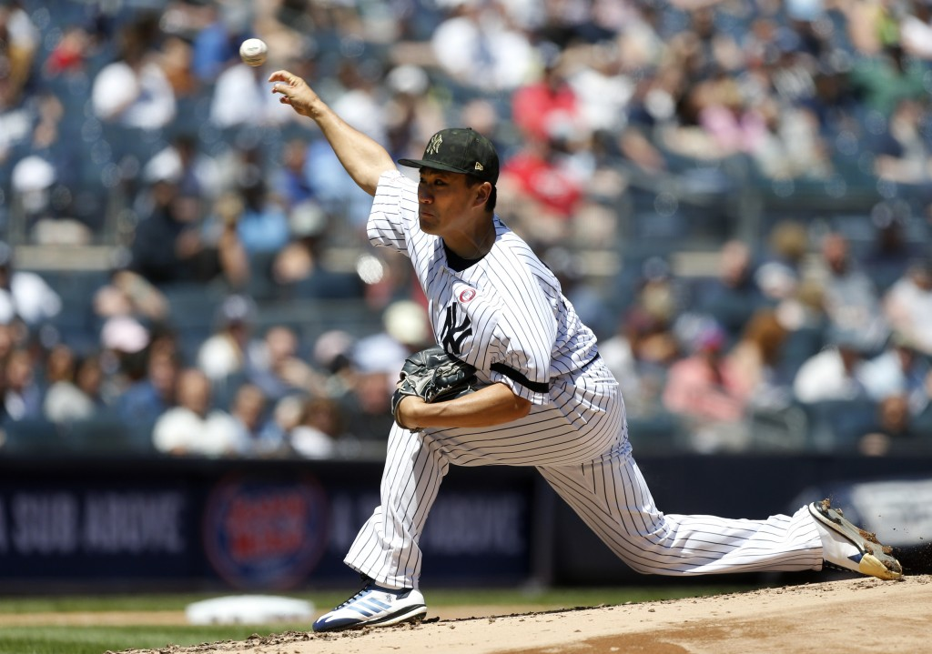 New York Yankees starter Masahiro Tanaka delivers a pitch against the Tampa Bay Rays during the second inning of a baseball game, Saturday, May 18, 20