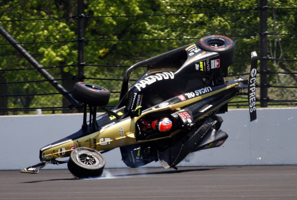 James Hinchcliffe, of Canada, goes airborne after hitting the wall in the second turn during qualifications for the Indianapolis 500 IndyCar auto race
