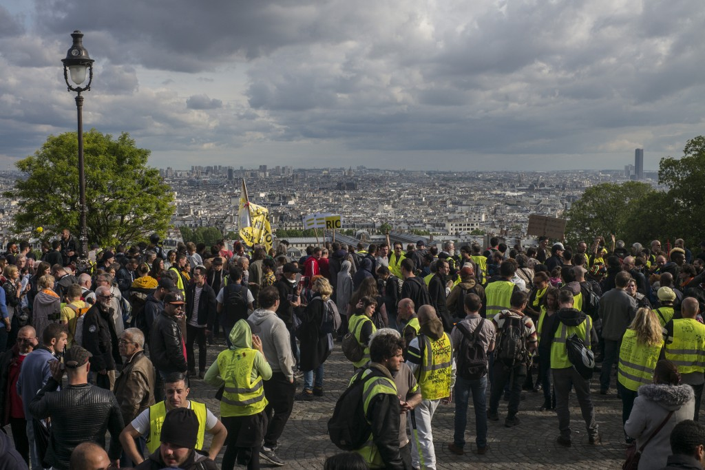 Yellow vest protestors gather in Paris, France, Saturday, May 18, 2019. Yellow vest protests are taking place for the 27th consecutive week to challen