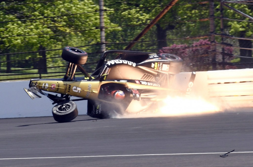 James Hinchcliffe, of Canada, slides into the backstretch after hitting the wall along the second turn during qualifications for the Indianapolis 500