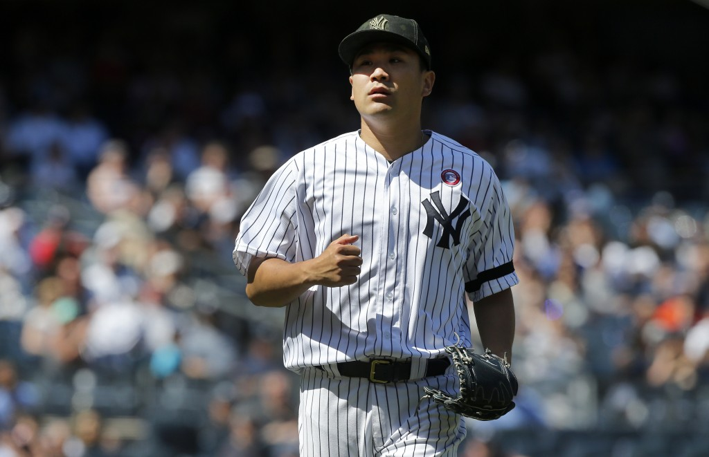 New York Yankees starting pitcher Masahiro Tanaka walks to the dugout after the sixth inning of a baseball game against the Tampa Bay Rays , Saturday,