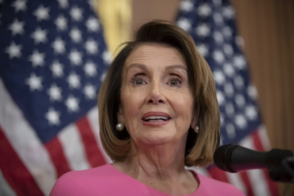 FILE - In this Nov. 7, 2018 file photo, House Minority Leader Nancy Pelosi, D-Calif., meets with reporters on the day after the midterm elections as D