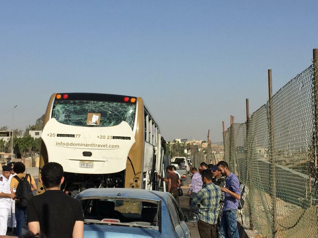 A bus and a car are parked after being damaged by a bomb, in Cairo, Egypt, Sunday, March 19, 2019. Egyptian officials say a roadside bomb has hit a to...