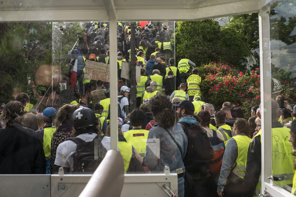 Yellow vest protestors march in Paris, France, Saturday, May 18, 2019. Yellow vest protests are taking place for the 27th consecutive week to challeng