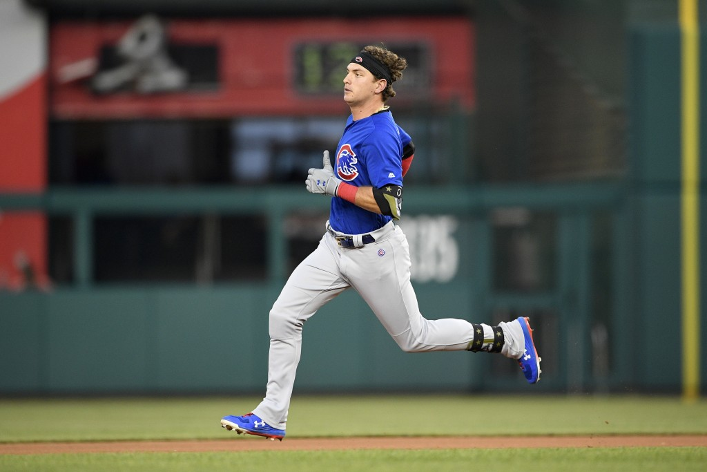 Chicago Cubs' Albert Almora Jr. runs to second with a double during the fourth inning of a baseball game against the Washington Nationals, Sunday, May...