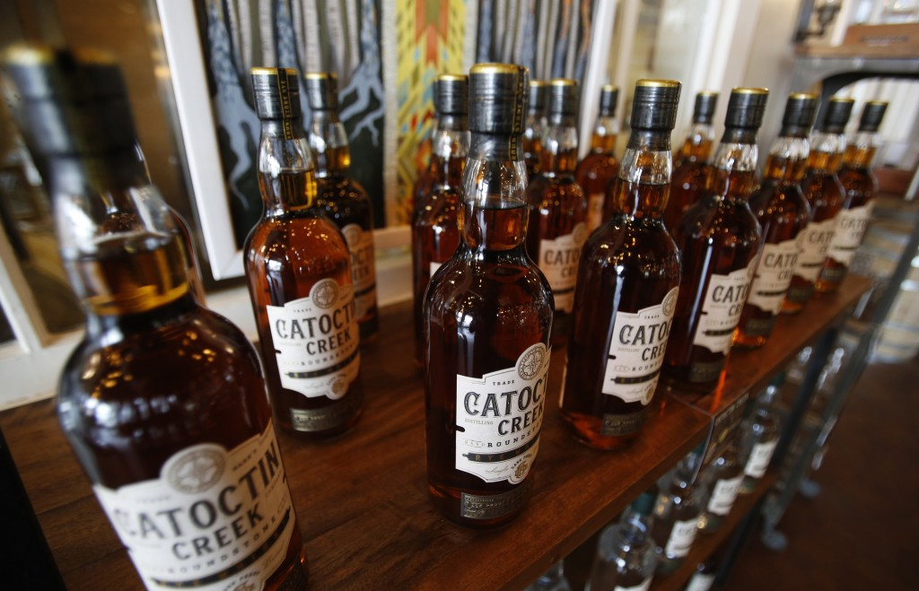 FILE - In this June 20, 2018 file photo, Catoctin Creek Distillery whiskey is on display in a tasting room in Purcellville, Va. American whiskey produ