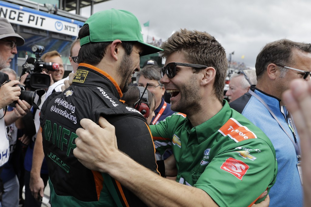 Kyle Kaiser celebrates with a crew member after qualifying for the Indianapolis 500 IndyCar auto race at Indianapolis Motor Speedway, Sunday, May 19,