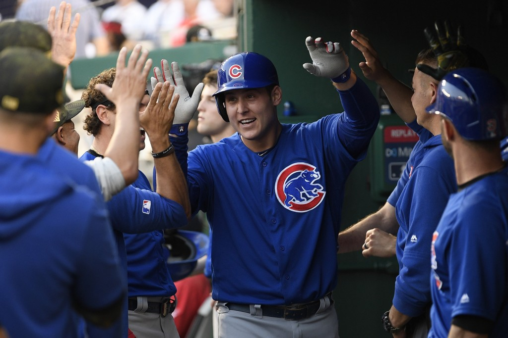 Chicago Cubs' Anthony Rizzo celebrates his home run in the dugout during the third inning of a baseball game against the Washington Nationals, Sunday,...