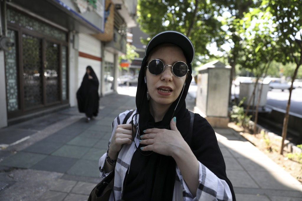"In this Friday, May 17, 2019 photo, civil servant Masumeh Izadpanah speaks during an interview in downtown Tehran, Iran. ""When someone keeps trying to"