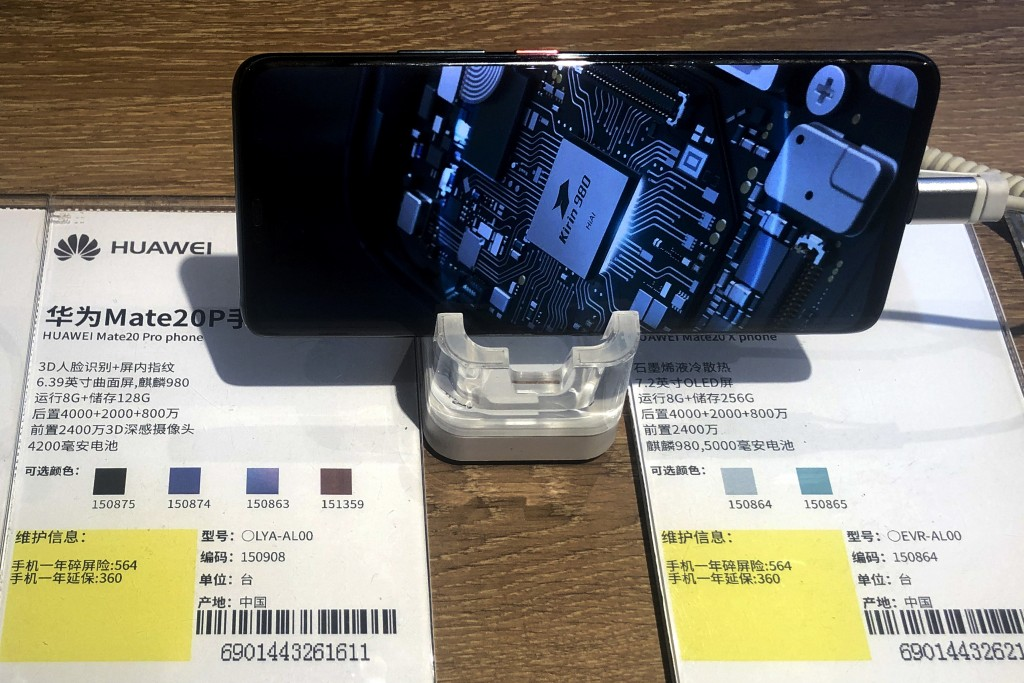 A Huawei Mate20P smartphone model showing its own Kirin chip processor is displayed at an electronic store in Beijing, Monday, May 20, 2019. Google as...