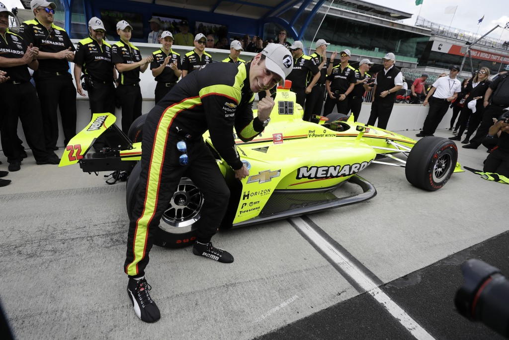 Simon Pagenaud, of France, celebrates after winning the pole for the Indianapolis 500 IndyCar auto race at Indianapolis Motor Speedway, Sunday, May 19...